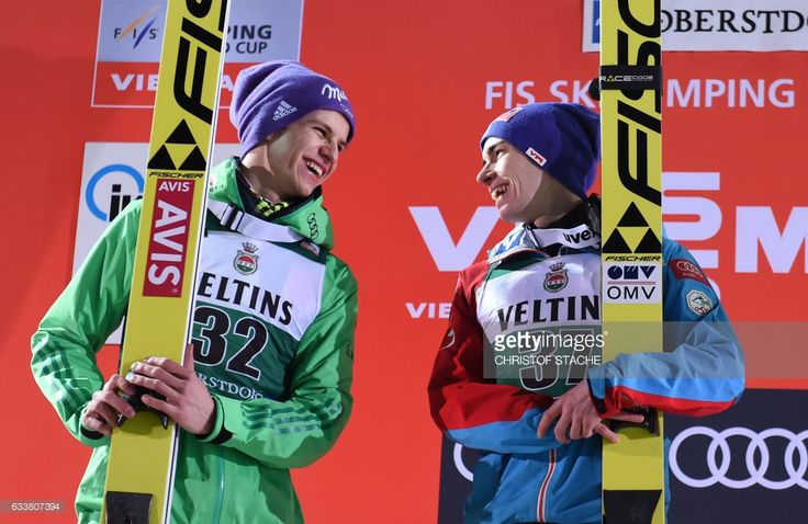 German Andreas Wellinger (L) and Austrian Stefan Kraft (R) joke together on the podium of the FIS ski jumping World Cup flying hill individual competition in Oberstdorf, southern Germany, on February 4, 2017. Austrian Stefan Kraft won the competition, German Andreas Wellinger placed second and Polish Kamil Stoch placed third. / AFP / Christof STACHE