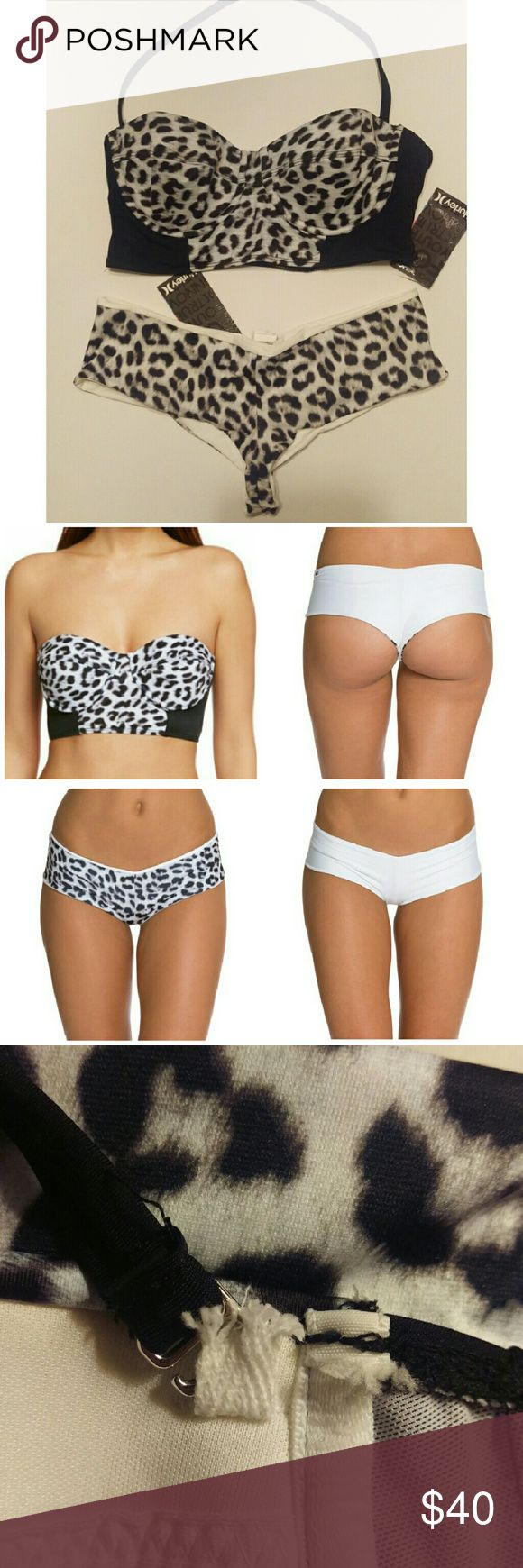 🏄🏻‍♀️☀️NWT Hurley Bustier Bikini Set New with tags Hurley underwire bustier and matching reversible bottoms. Longline top has removable halter strap and molded bra cups. Reversible cheeky bottoms  are cheetah and white. Only flaw is a small tear on the inside of top where removable strap hooks on. Although, it does not affect wear and cannot be seen. *price firm* Hurley Swim Bikinis