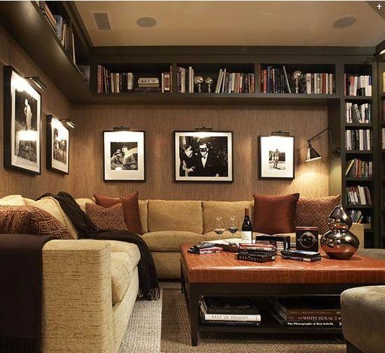 bookshelves basement family room.  pretty cool.  love the lighted black and white photos.