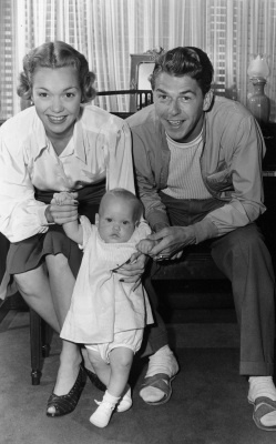 Jane Wyman and Ronald Reagan, are holding their 9-month-old daughter Maureen Elizabeth, on September 13, 1941, at their Hollywood, Calif., home. (AP Photo)
