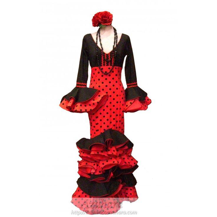#Traje de #flamenca en negro y rojo, dos tonalidades muy elegantes. Destaca el vuelo de volantes en la parte inferior y mangas.