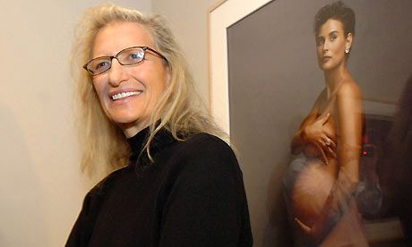Annie Leibovitz with her famous portrait of a pregnant Demi Moore. Photograph: KPA/Zuma/Rex Features