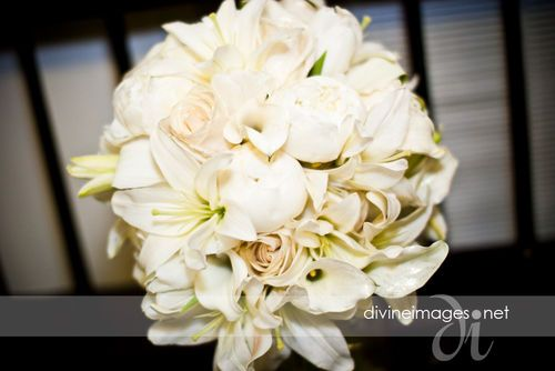 The bride's bouquet: white lilies, calla lilies, vendela roses kissed with gold, and lush peony