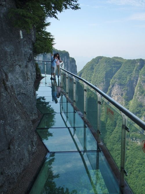 """Glass walkway on Tianmen Mountain  Hunan, China is 4000 ft high and the glass is only 2 1/2"""" thick. Would you? Could you?"""