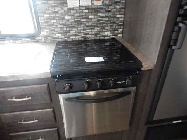 """2016 New Forest River EVO 240BHS Travel Trailer in Utah UT.Recreational Vehicle, rv, FINANCING AND EXTENDED WARRANTY AVAILABLE. ASK A SALESMEN FOR DETAILS.DARREN BIDEAUX RV DLR#7829801-392-24001448 W 2100 S OGDEN UT2016 Forest River EVO 240BHAwning 18'GVWR 7645 lbsOver all length 28'9""""Fresh water tank 56 galHeater AC6 gal water heaterCharging centerStereo Outside speakersOutside showerTV hook up Walk around bed U-shaped dinette Large sink bowl 3 burner stove & oven Microwave Fridge…"""