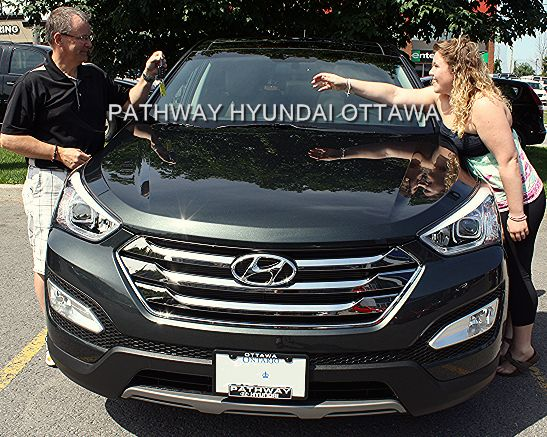 """Mark Gibson bought a 2013 Santa Fe from Pathway Hyundai. """"This is our third Hyundai from Pathway. Getting an automatic was important because my daughter is a new driver. I love the panoramic roof, the way it performs and it's VERY comfortable! It's one of the best rated SUVs and a very safe car – that's important, with my daughter driving. My insurance went down when I bought it. And the ride is smooth, it handles wonderfully. I give it a 12 on a scale of one to 10. Visit…"""
