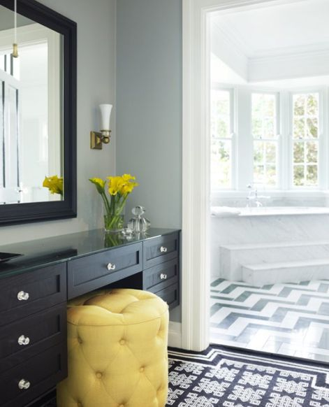 love the stool with the vanity and the bright stepped tub in the bathroom