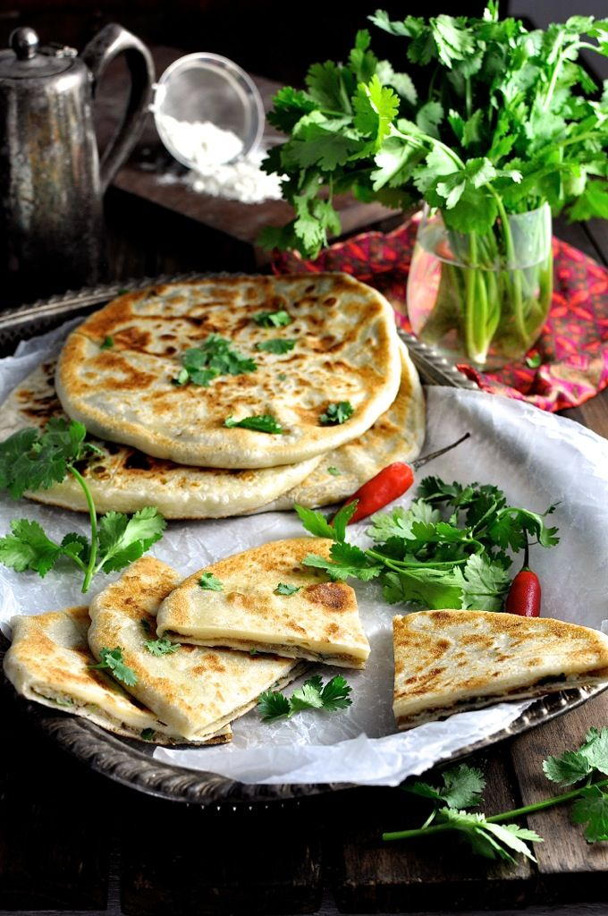 Aloo Paratha (Indian Potato Stuffed Flatbreads) - the bread is made with just flour, salt and water and is so easy to work with (mess free!). Filled with spiced potato. Addictive!