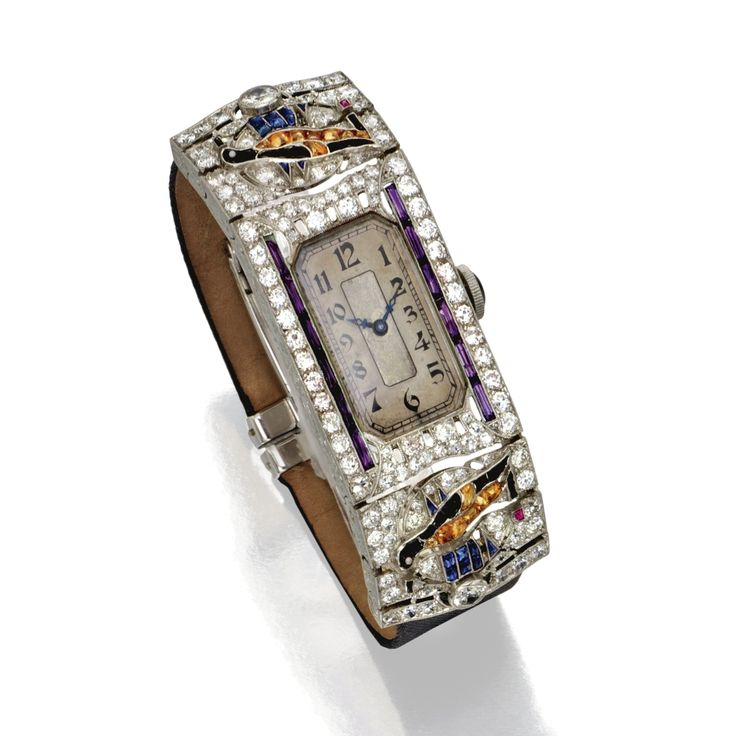 platinum diamond and colored stone wristwatch circa movement signed longines and numbered