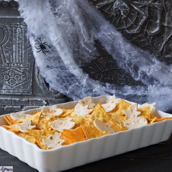 This Mexican chicken nacho casserole made with chicken, tomato sauce and covered  with crunchy nachos