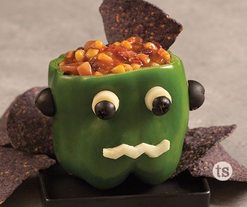 Chips & Salsa Monster Recipe│Green pepper with string cheese and olives to create a silly monster face. Stuffed with salsa and serve with chips!