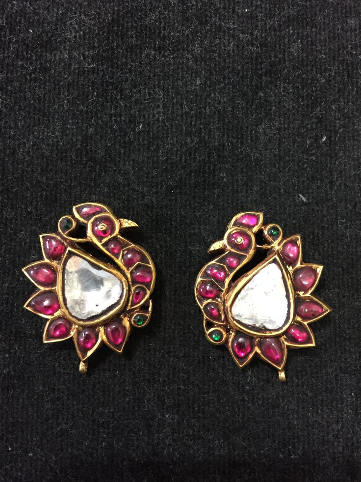 Bird design earings, rubies with uncut diamonds in gold. South Indian jewellery.