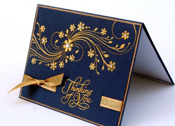 Thinking of you embossed card in navy blue and gold.  A spray of flowers with small crystal centers.