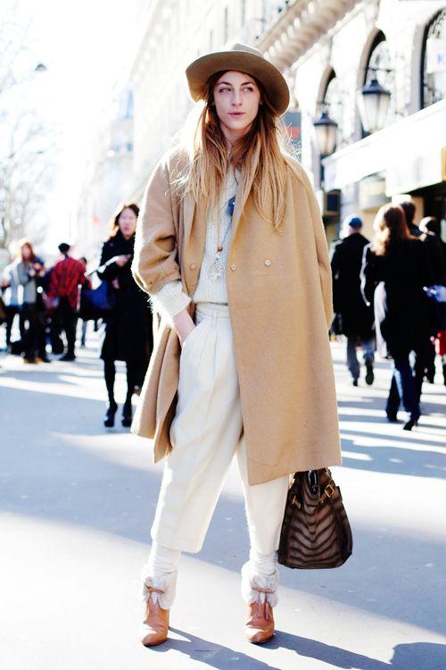 She looks suspicious, but I like her camel coat.
