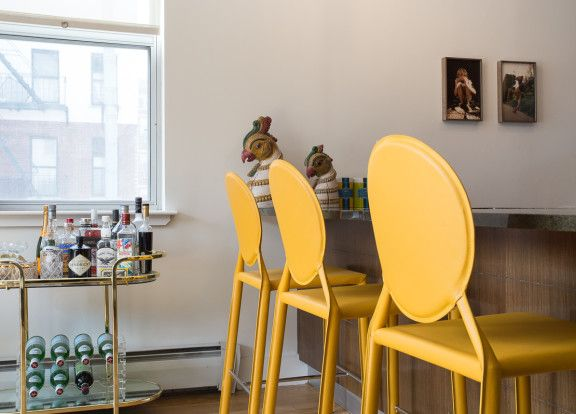 """Homepolish Interior Design   The <a href=""""http://www.apt2b.com/valencia-ave-all-leather-side-counter-height-stool-yellow-2063"""" target=""""_blank"""">yellow chairs</a> next to the brassy bar cart is an unexpected and amazing pairing."""