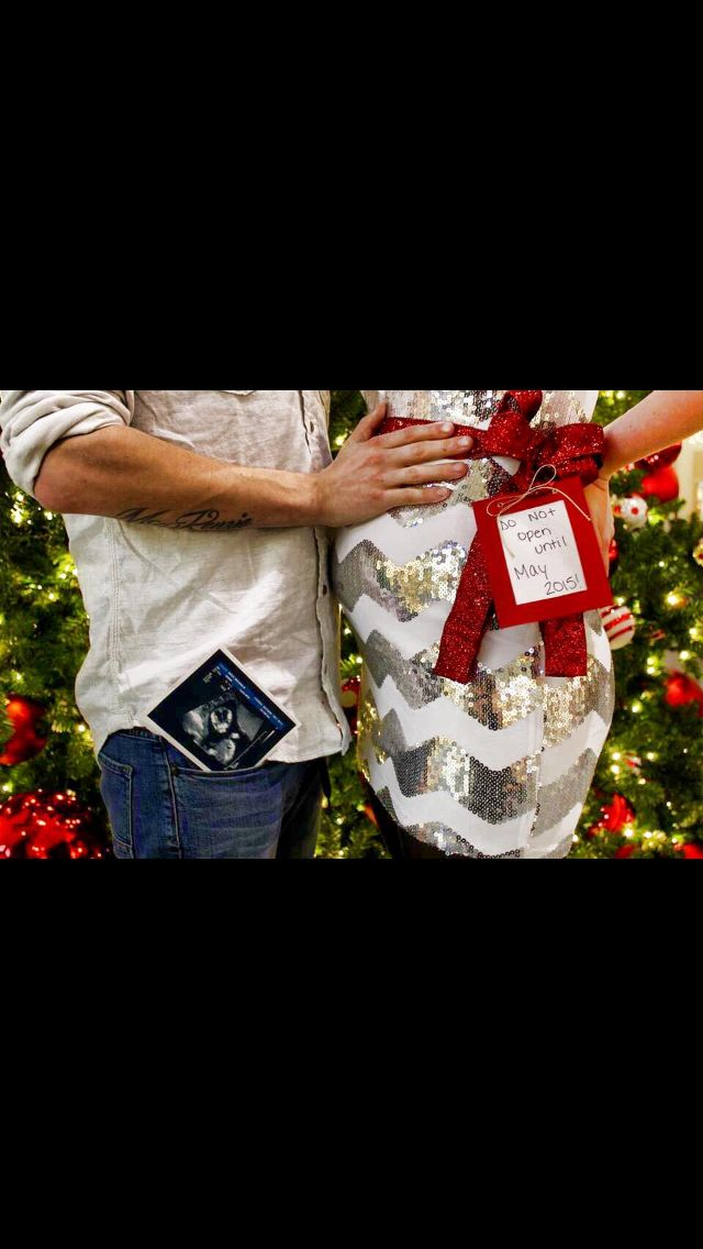 Pregnancy announcement Christmas surprise with bow, tags, ultrasound & Christmas tree as background!