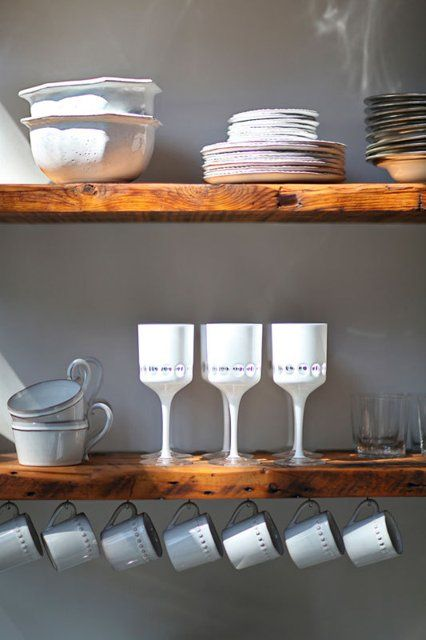 reclaimed wood shelving - love the tone of wood & the mug hooks