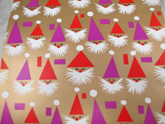 This vintage wrapping paper measures about 15 wide x 12 ft. It features abstract, geometric Santa faces in red, purple and white against a metallic gold background. I believe it is very late 60s or 70s era. It is in very good condition with a minor bit of wrinkling on one edge where roll was bumped. Please see photos. This would be perfect for wrapping gift boxes under an retro, mod tree. It would also be good to use in scrapbooking or Christmas crafts!   The paper will ship rolled in a…