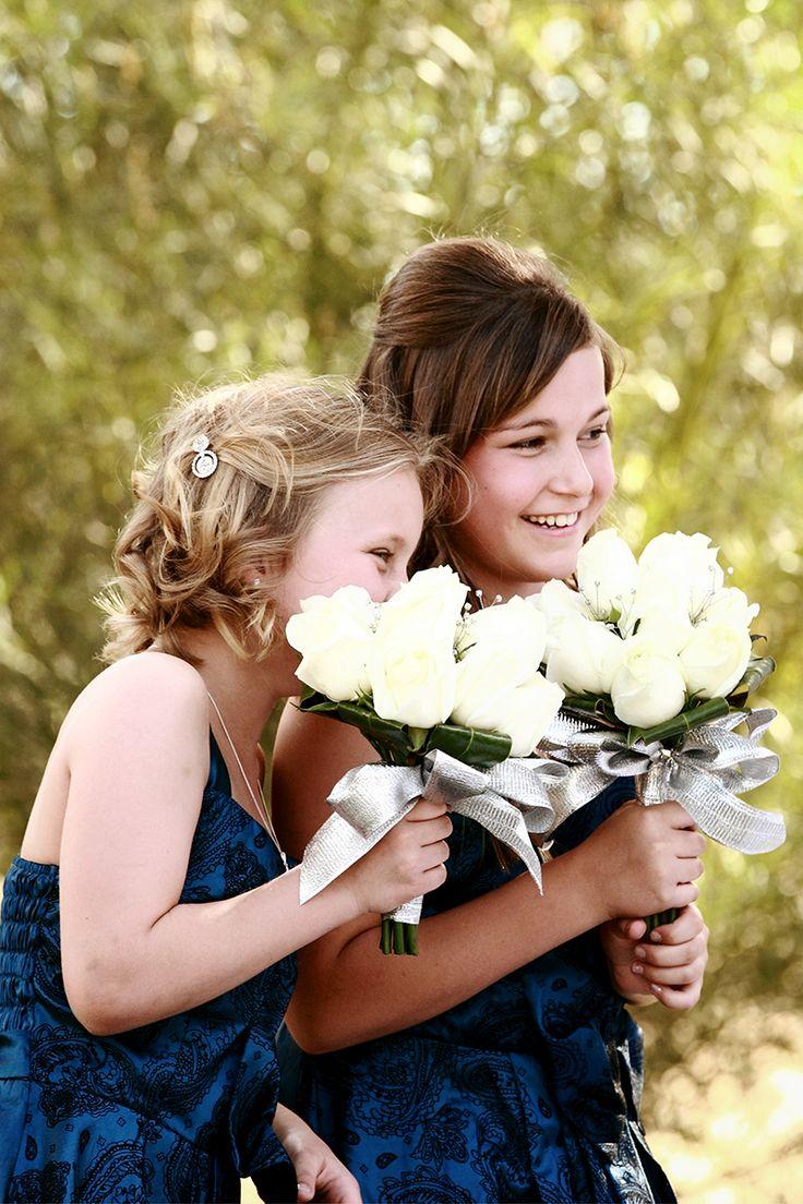 Kalgoorlie Wedding Photographer, flower girls, giggling girls, blue dress, pale yellow bouquet