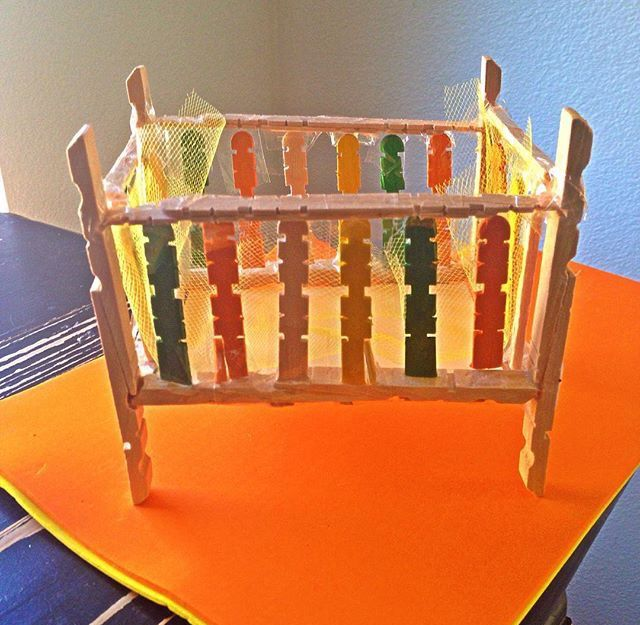 Recycled baby crib (baby shower prop) made with clothing pins, and pop cycle sticks ♻️