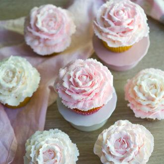 These cupcakes are the perfect treat for Easter. You can use your favorite cupcake recipe, whip up a batch of buttercream and make or buy some fondant. I used an Ateco 133 tip for the grass and round piping tips for the paws. Use a small amount of water to join all the pieces together. As you can see I used a glass to form the rounded body, you might try using a plastic egg, or small bowl too.