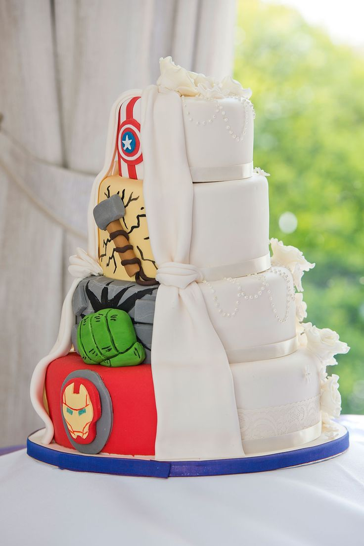 We love that each tier has been decorated with a different hero – you could even pick different wedding cake flavours for each one so that the inside of the cake is just as much of a surprise  Image credit: Discovery Photographic