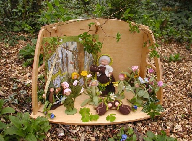 spring nature table with root children.. i love this wooden background.
