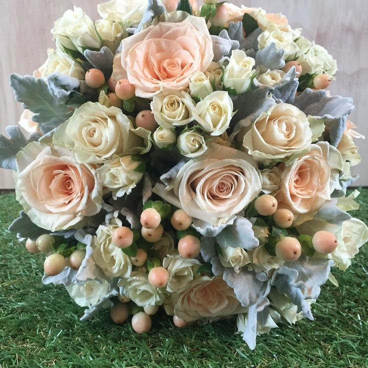 Soft Cream and apricot, peach bride bouquet created and designed by Madison in Bloom Floral design. Bouquet includes roses, spray roses, hypericum berries and dusty miller. www.madisoninbloom.com.au https://www.instagram.com/madisoninbloom/ https://www.facebook.com/MadisoninBloom/