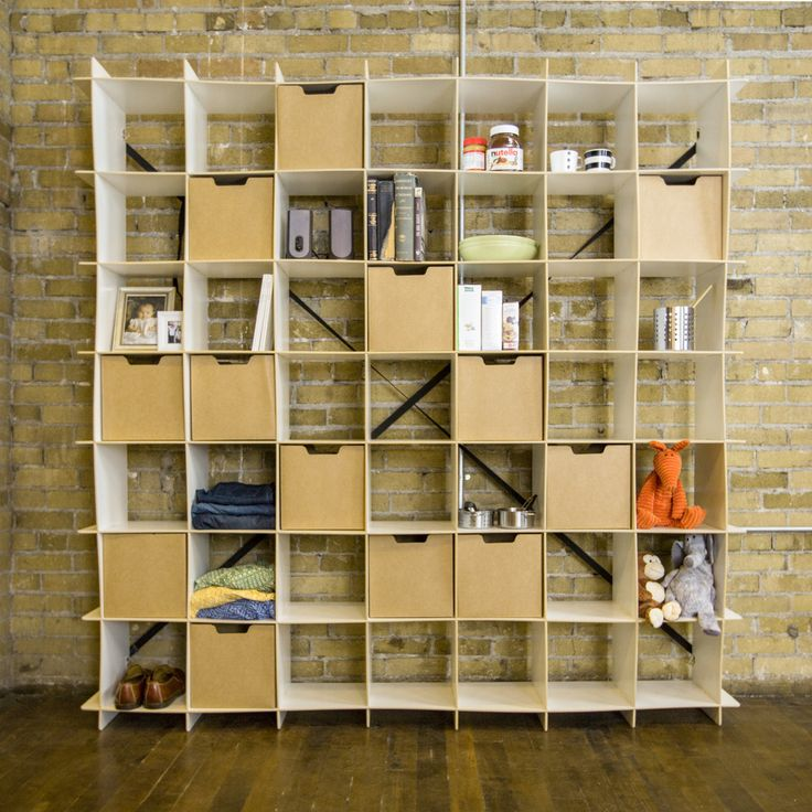 Unique, simple, and versatile! This forty-nine cube shelving unit is perfect for small apartment storage and decorating. Sleek and sturdy, this bookcase is perfect for displaying, organizing or both!