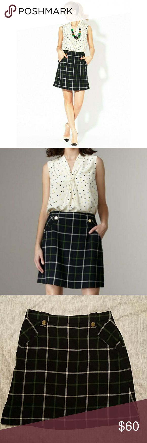 Kate Spade Plaid Fallon Skirt EUC Kate Spade skirt the rules skirt WITH POCKETS! yes, dreams do come true lol   The skirt is navy blue with green and white stripes and gold buttons. It has a hidden zipper on the side and sits at your natural waist   Feel free to ask any questions or make offers kate spade Skirts