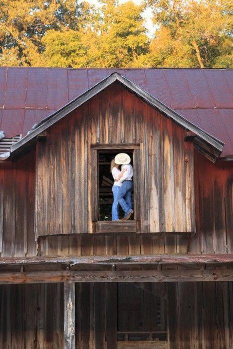 Kissing in barn loft engagement photo