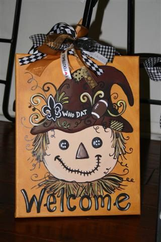 New Orleans Saints football scarecrow. Cute!  OMG LOVE! This is the next one I will be painting!!!!! LOVE LOVE LOVE!!!!