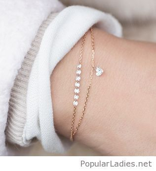 Lovely gold bracelets with a little heart