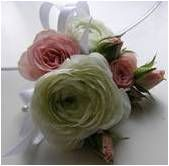 BR-18. Two ranunculus and baby roses