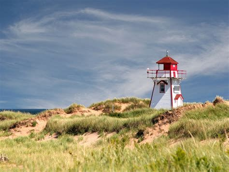 """PEI National Park: Miles of sand dunes, beaches, sandstone cliffs and walking trails make up the park, which is also the home of the Green Gables house. Green Gables is the farm that inspired the setting of """"Anne of Green Gables."""""""