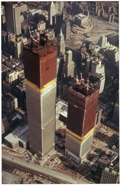 Aerial view of the Twin Towers of the World Trade Center under construction looking northeast. February 1971