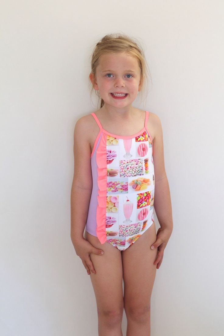 Girls Swimmer sublimated one piece featuring candy collage and pink frill. by LaLaLaDesigns on Etsy