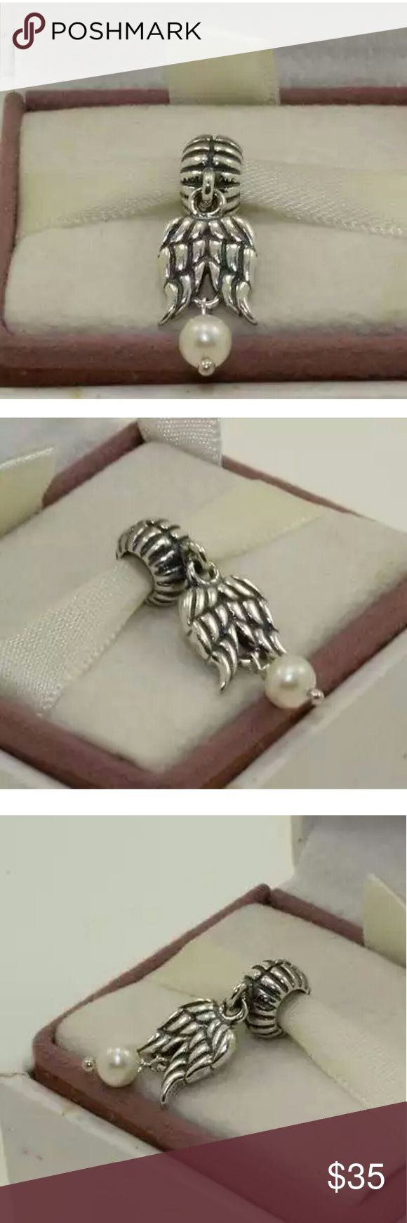 Authentic Pandora Guardian Angel Charm New without tags Authentic Pandora Sterling Silver Guardian Angel White Pearl Dangle Charm. Pandora Jewelry Bracelets