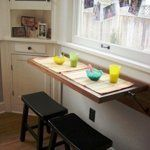 Last week, I revisited some of our Kitchen Tours to look at extra counter space added by way of islands, carts, and tables. But, some of you asked, what about adding counter space to super small kitchens without room for the smallest of stands or carts?