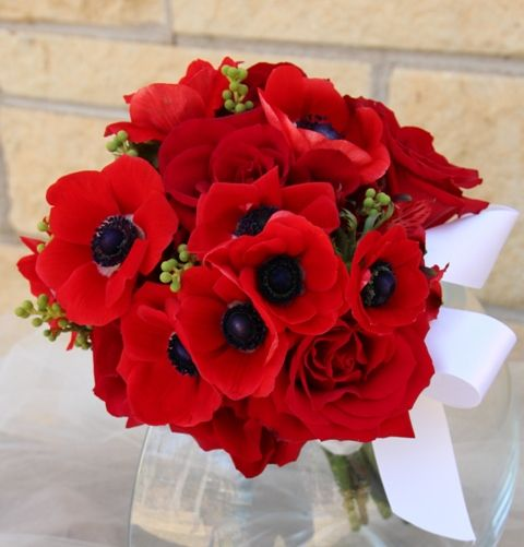 red anemones combined with roses