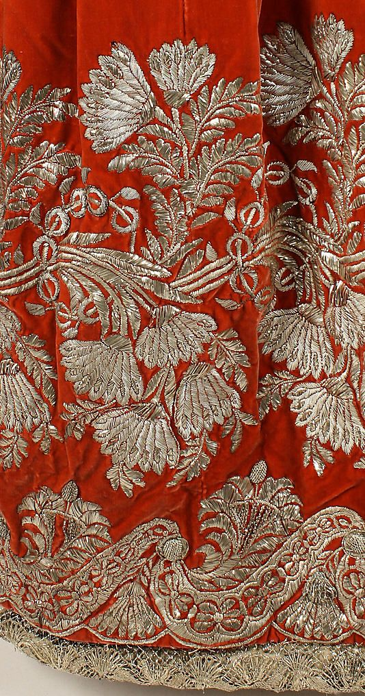 beautiful detail of red silk velvet gown with the exquisite silver thread embroidery.