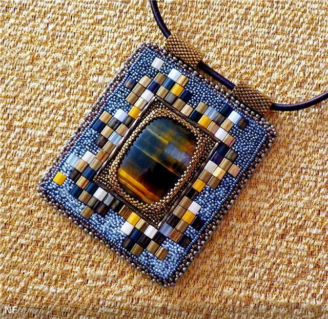 """Geometry in the classics"" pendant by na-ta-li on biser.info. Inspired by the works of Alla Maslennikov. I can't figure out if the background is beadwoven, embroidered, or glued mosaic."