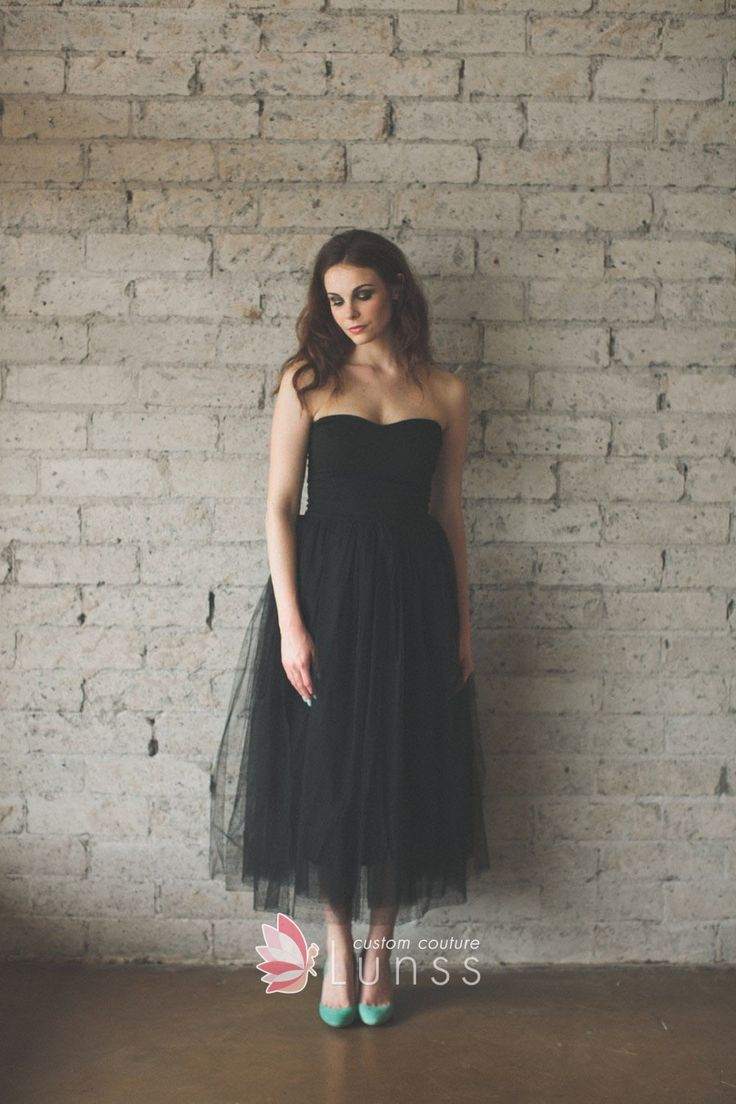 Black tulle strapless ankle length vintage inspired bridesmaid dress. Strapless bodice with subtle curved neckline, pencil skirt with layered tulle.