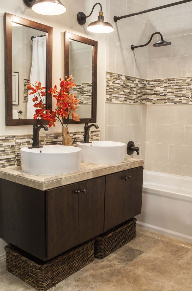 This transitional styled bathroom features ceramic tile walls and natural stone floors accented with glass and stone mosaic. #thetileshop