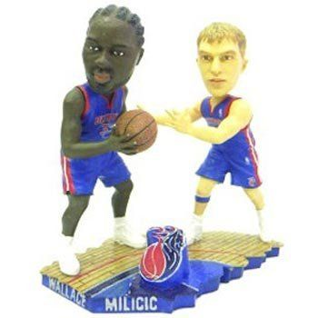 Detroit Pistons Milicic & Wallace Bobble Mates (Quantity of 1) by Caseys. Forever Collectibles NBA Bobbleheads. These figures come with two regular size bobble heads on the same base. Each set of two represents a classic play or formation within it's given league! NBA sets showcase the famous AllyOop play for the slam dunk! These sets are hand painted and individually numbered of ONLY 504 made! Bobble Mates by Forever Collectibles capture the essence of the game!.