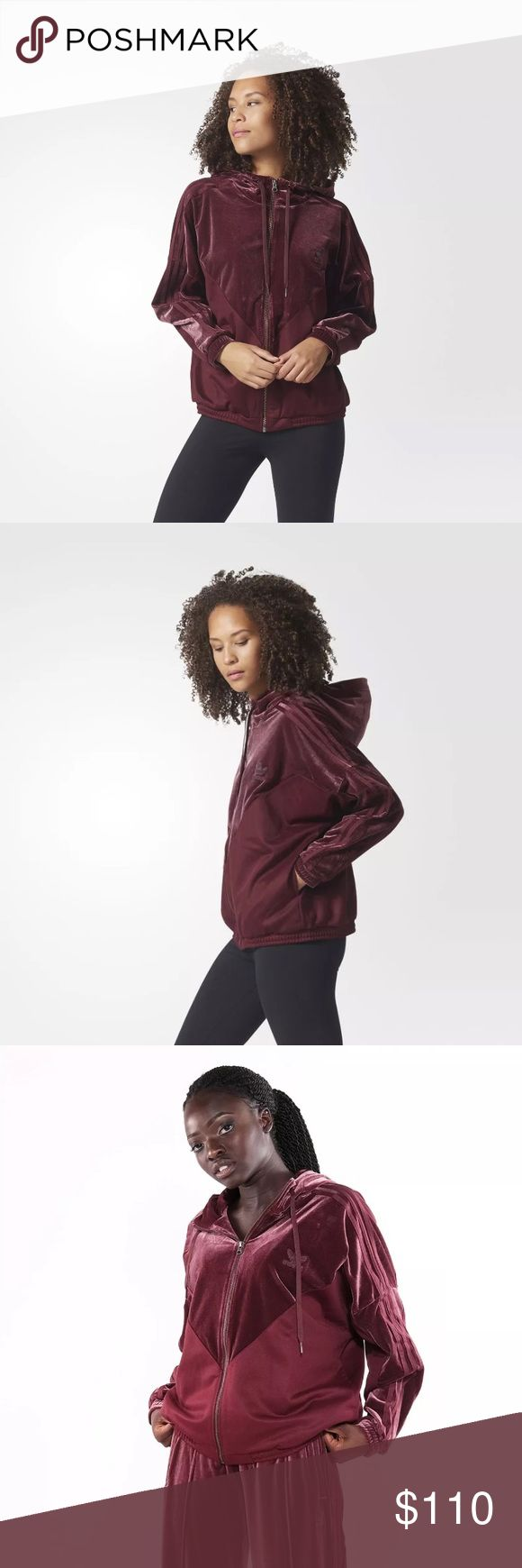 Adidas Velvet Vibes Oversize Hoodie Jacket Velvet meets the streets to create the stylish urban look of this women's hoodie. Sporty piqué brings a textured contrast, and the oversize fit gives off casual, trendy vibes.   Full zip with adjustable hoodie Ribbed cuffs and hem 3-Stripes on sleeves Embroidered Trefoil logo on chest Oversize fit Hoodie, shoulders and sleeves: 91% polyester / 9% elastane velvet; Lower body: 52% cotton / 48% polyester piqué Imported Product code: CW0270 Product…