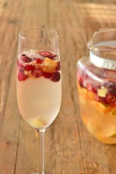 Champagne Sangria Recipe - Sangria in the winter? Heck yeah! Especially when you throw in some Champagne, cranberries and oranges.
