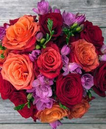 Red and Orange Roses and Freesia accents from The Bouqs.com