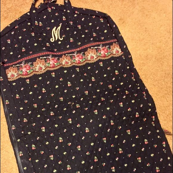 """VERA BRADLEY GARMENT /HANGUP BAG VERA BRADLEY GARMENT /HANGUP BAG. Retired Pattern Petit Point.  Black w/ Floral Print.  Has Zippered Closures, 2 handles, also for Hanging, two outside Zippered Pockets.  Ribbon ties on inside. Folds in half Only used a couple times.  Has Embroidered """"M"""" on front.  EXCELLENT CONDITION. No Rips, or Stains. Vera Bradley Bags Travel Bags"""