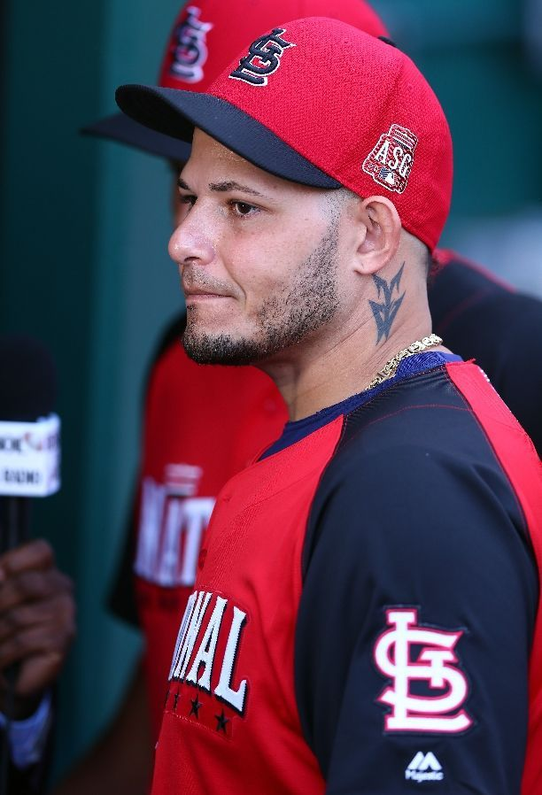 All Star Yadier Molina stands in the dugout during the All Star Workout 7-13-15
